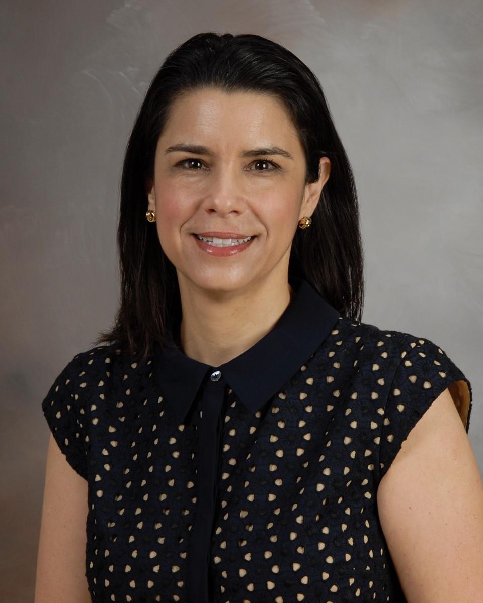 headshot of Maria S. Carlo